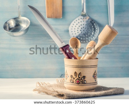Kitchenware items on the kitchen table - stock photo