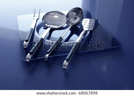 kitchenware kitchen utensils blue table and stainless steel - stock photo