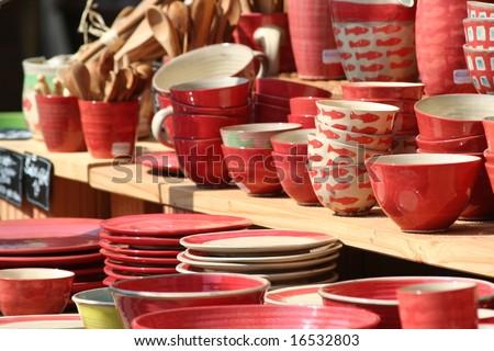 Kitchenware on sale on a market - stock photo