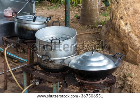 Kitchenware, pot, pan in restaurant kitchen - stock photo