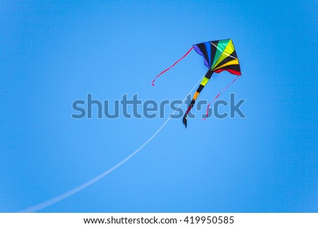 kite flying in a clear blue sky - stock photo
