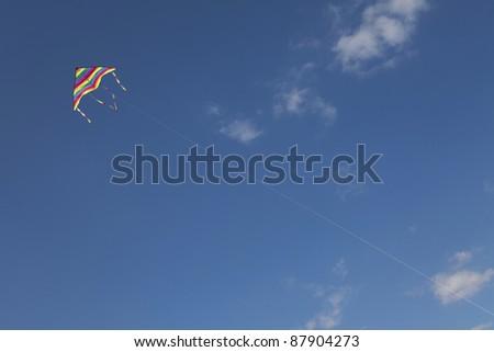 kite flying on blue sky - stock photo
