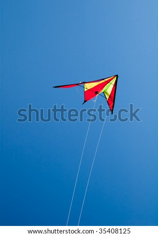 kite flying on clear blue sky - stock photo