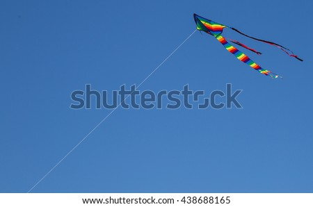 Kite hit from the Sun on a background of blue sky
