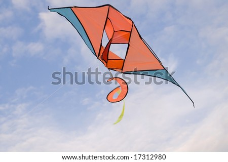 Kite in the blue sky (summer background)