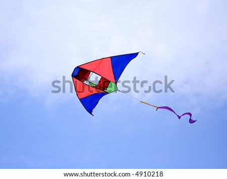 Kite over the blue sky