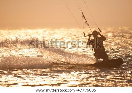 Kite Surfer at sunset - stock photo
