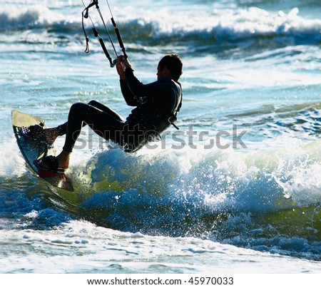 Kite Surfer in the waves - stock photo