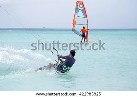 Kite surfer on Aruba island in the Caribbean - stock photo