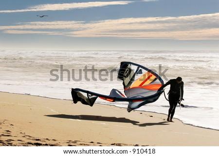 Kite surfer on the beach at Santa Cruz, California - stock photo