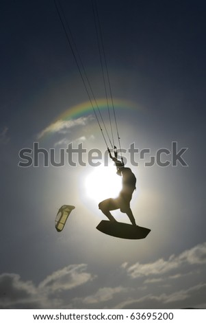 Kite surfer silhouette, jumping and flying high in the air, at the Obidos lagoon, Bom Sucesso, Foz do Arelho, Silver Coast, Portugal - stock photo