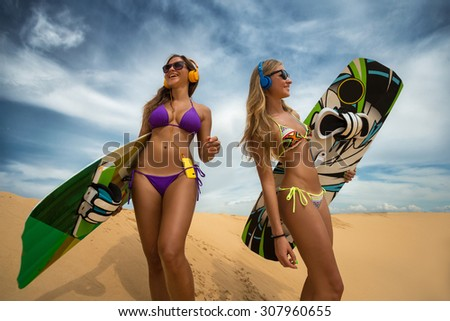 Kite surfers party freestyle at dunes - stock photo
