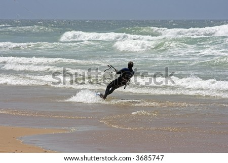 Kite surfing at the atlantic ocean in Portugal