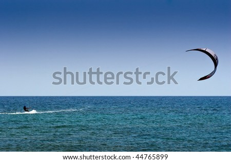 Kite surfing in the ocean - stock photo