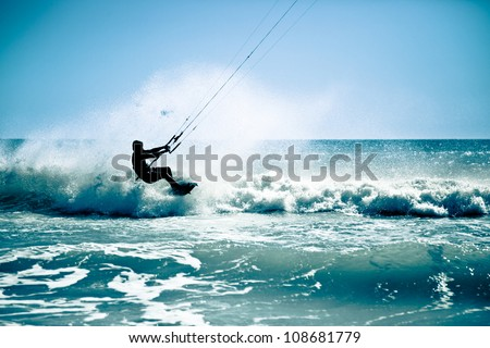 Kite surfing in waves. Splash - stock photo