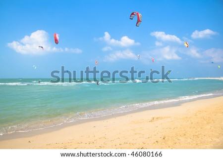 Kite surfing on a pristine beach in Dubai - stock photo