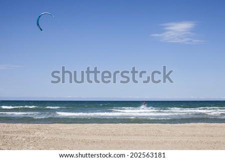 Kite surfing on the beach - stock photo