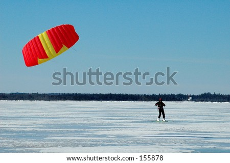 Kite surfing traction skiing - stock photo