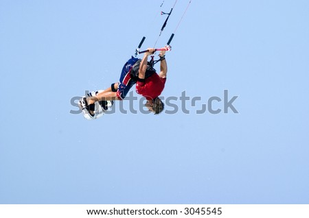Kiteboarder doing a handle pass