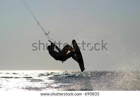 kiteboarder taking off for a jump - stock photo
