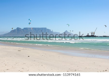 Kiteboarders at Milnerton Beach in Cape Town, South Africa - stock photo