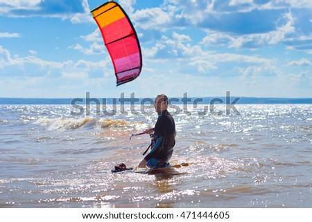 Kiteboarding.  A kite surfer go in the water