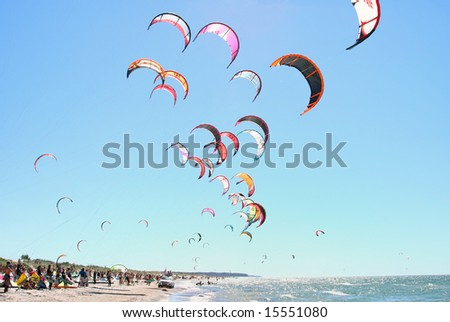 Kiteboarding competition, many kites in the sky - stock photo