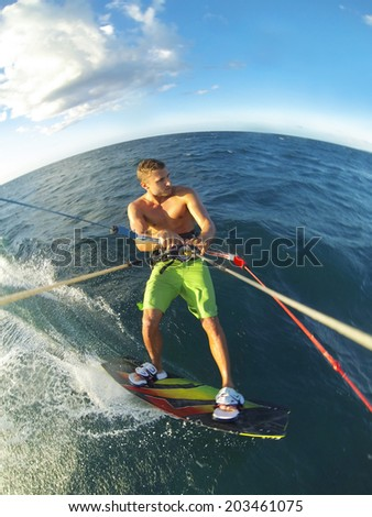 Kiteboarding, Fun in the Ocean, Extreme Sport. Action Camera POV angle with motion blur. - stock photo