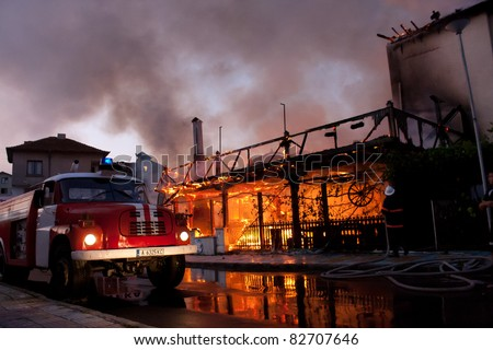 KITEN, BULGARIA - AUGUST 4: Two restaurants and one three-floor house burnt out in that fire. No people were harmed. The fire has resulted from electric supply left turned on during the night. Kiten, Bulgaria, August 4, 2011 - stock photo