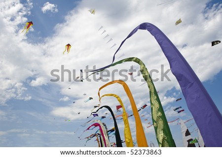 Kites flags and banners on beach. Cervia International Kite Festival, Italy. - stock photo