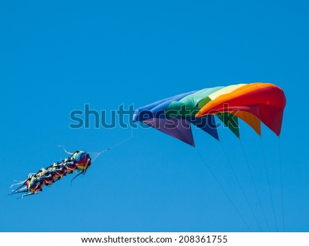 Kites Flying in Cloudless Sky at the Long Beach Kite Festival Washington USA - stock photo