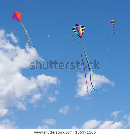 Kites flying in the sky, fun and exciting for children - stock photo