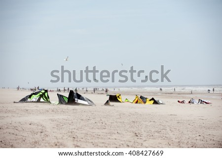 Kites lying at the Beach - stock photo