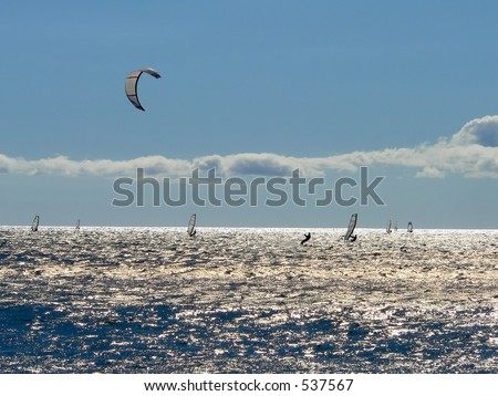 Kitesailor in a crowded ocean in Maui, Hawaii - stock photo
