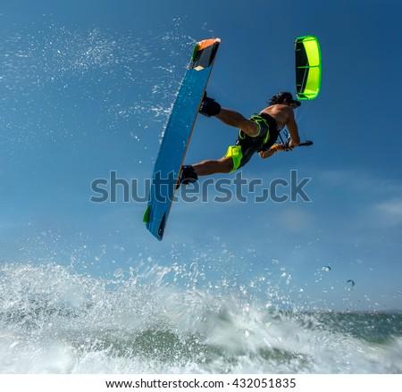 Kitesurf freestyle at sunset. - stock photo
