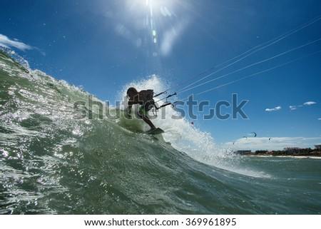 Kitesurf freestyle ride his kite - stock photo