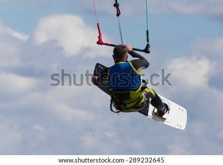 kitesurfer jumping in the air with the board