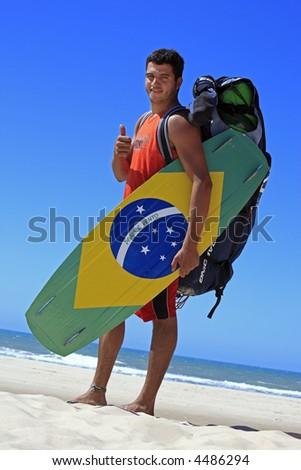 Kitesurfer with the brazilian painted on the board in prainha beach near fortaleza - stock photo