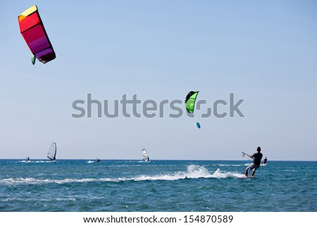 Kitesurfers  in sea. Greece. - stock photo