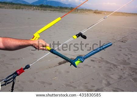 Kitesurfing action on the beach - stock photo