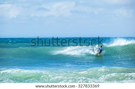 Kitesurfing background. Freestyle boarding on ocean waves  - stock photo