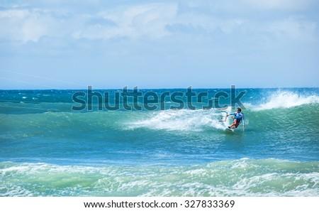 Kitesurfing background. Freestyle boarding on ocean waves  - stock photo