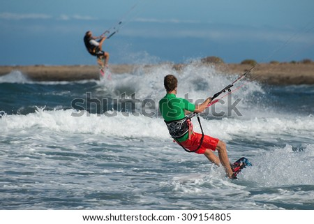 kitesurfing extreme sport with the wind freestyle - stock photo