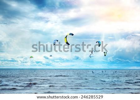 kitesurfing on a sunny day - stock photo