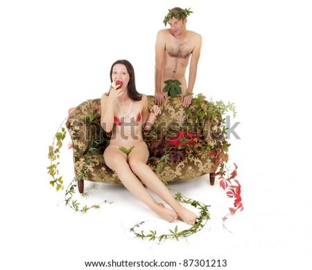 kitsch couple seduction on retro couch, original sin concept - stock photo