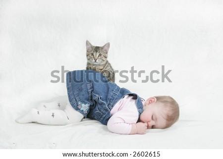 kitten sitting on baby - stock photo