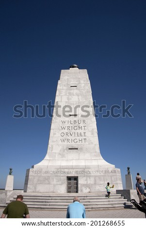 Kitty Hawk, NC, USA - September 25, 2012 : Tourist admiring the monument to Orville and Wilbur Wright at the Wright Brothers National Memorial in Kitty Hawk, Outer Banks, North Carolina - stock photo