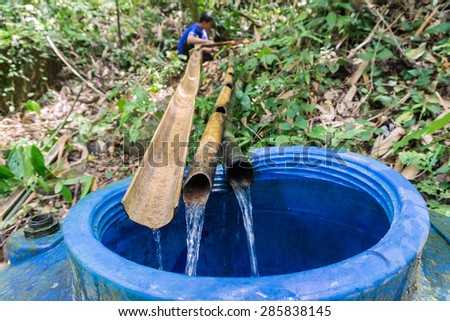 Kiulu Sabah Malaysia - June 9, 2015:Clean source of water from the jungle being maintain by unidentified villager.Remote place in Borneo depends on small stream to supply water for daily consumption.  - stock photo