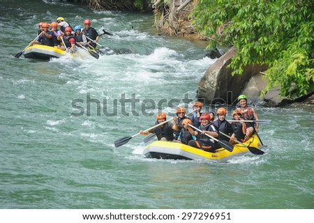 Kiulu Sabah Malaysia - June 7, 2015.Group of adventurer doing white water rafting activity at Kiulu river Sabah Malaysian Borneo on June 7, 2015. - stock photo