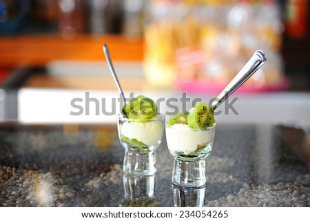 kiwi and cheese  in glass